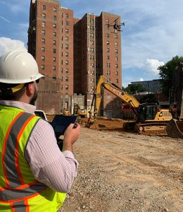 drone being flown on construction site